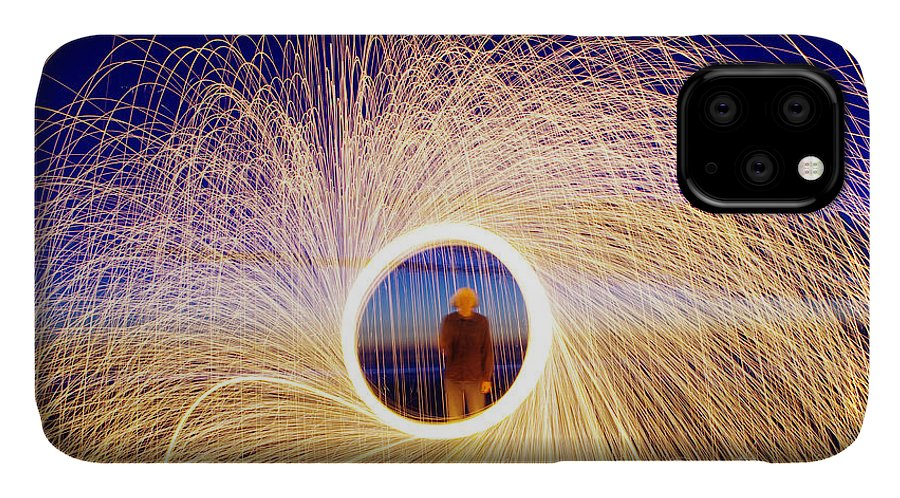 Heat IPhone Case featuring the photograph Burning Steel Wool Spinned Near The by Andrius saz