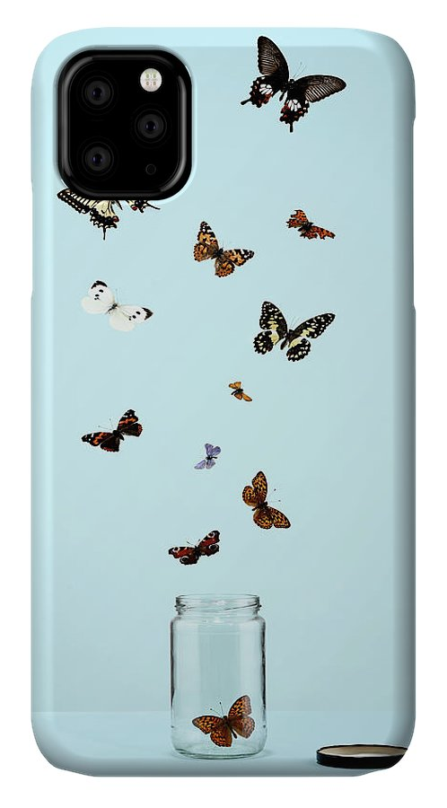 Animal Themes IPhone Case featuring the photograph Butterflies Escaping From Jar by Martin Poole