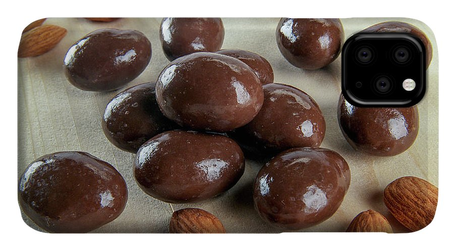 Carob IPhone Case featuring the photograph Carob Chocolate Coated Almonds A4 by Amit Strauss