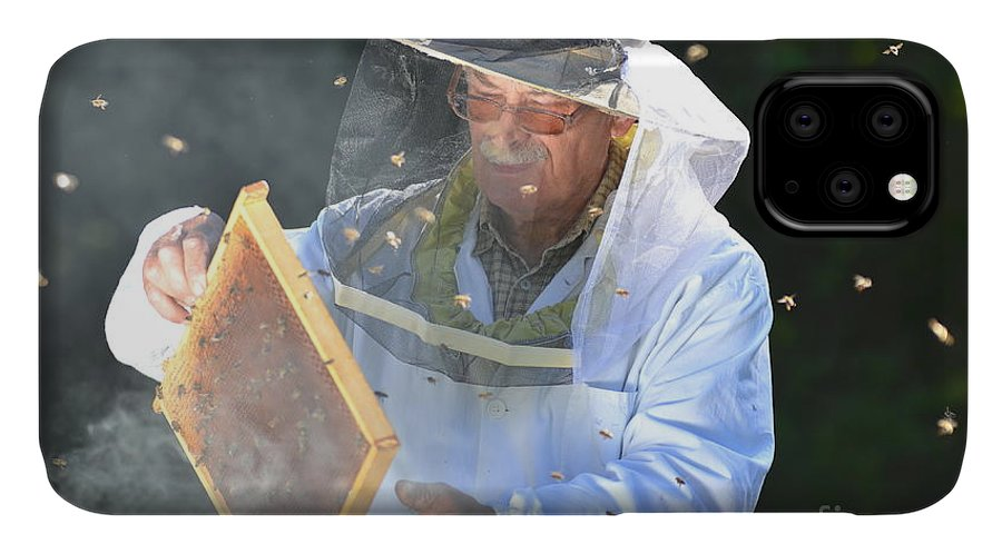 Bee IPhone Case featuring the photograph Experienced Senior Beekeeper Making by Darios