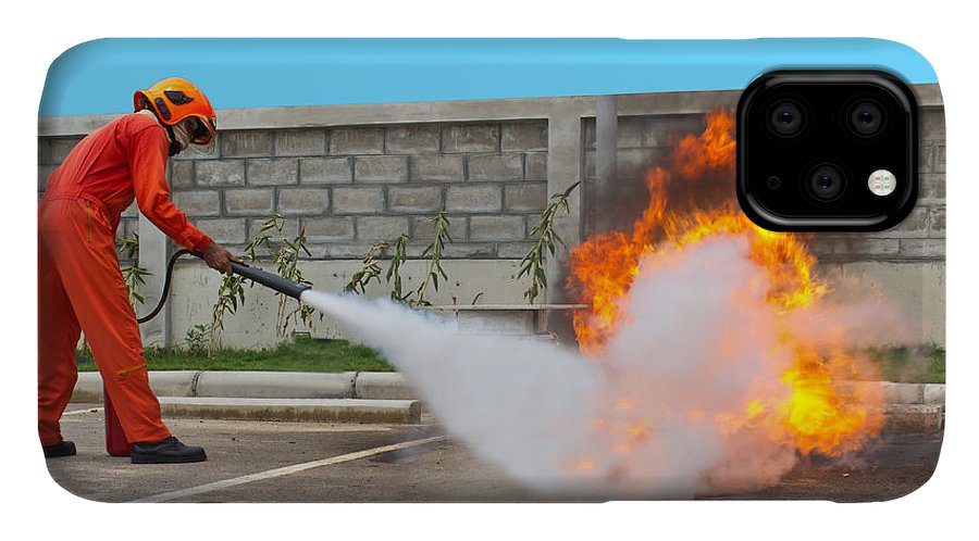 Heat IPhone Case featuring the photograph Fighting Fire During Training by Yutthaphong