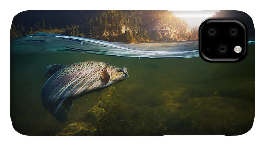 Flare IPhone 11 Case featuring the photograph Fishing. Close-up Shut Of A Fish Hook by Rocksweeper