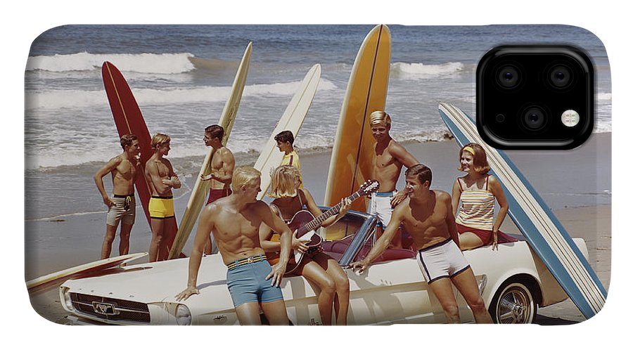 Young Men IPhone Case featuring the photograph Friends Having Fun On Beach by Tom Kelley Archive