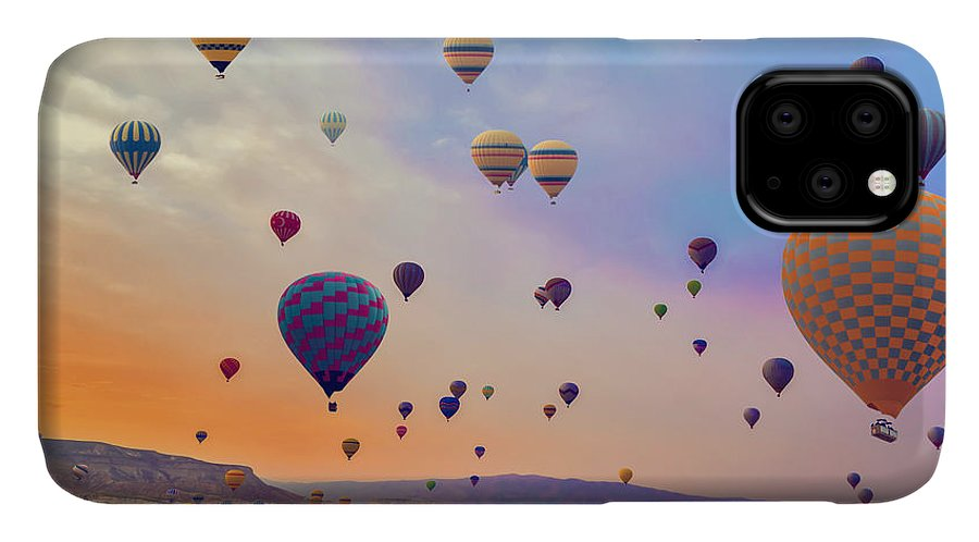 Heat IPhone Case featuring the photograph Hot Air Balloons Flying Over Mountains by Vladyslav Danilin