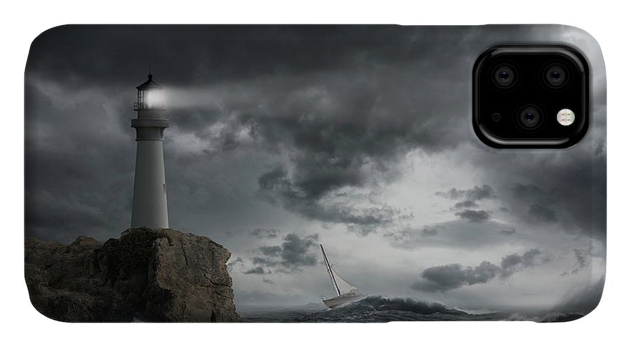 Risk IPhone Case featuring the photograph Lighthouse Shining Over Stormy Ocean by John M Lund Photography Inc