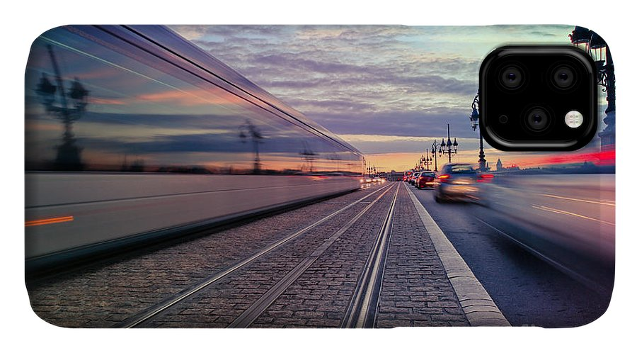 Bordeaux IPhone 11 Case featuring the photograph Long Exposure Of A Tram Passing On The by Saranya33