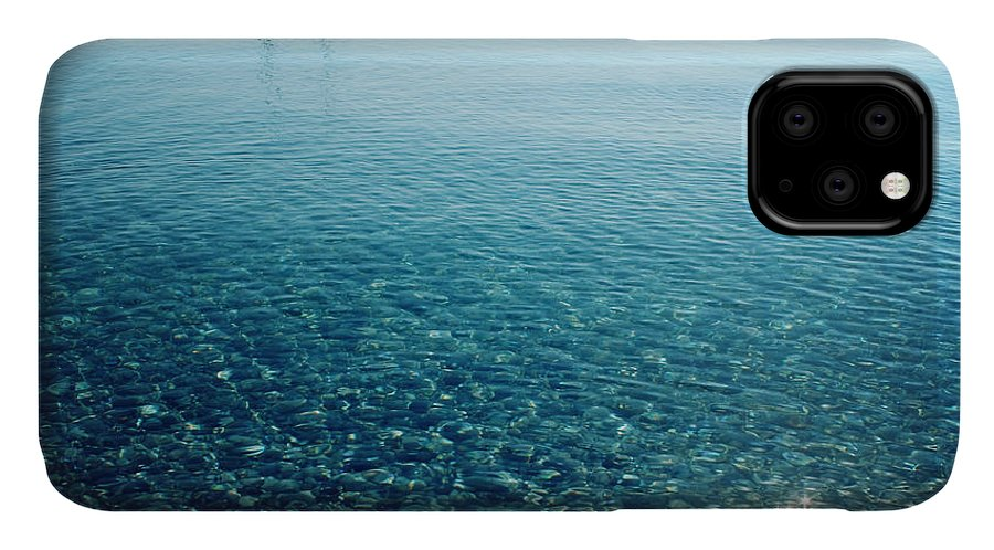 Sailboat IPhone Case featuring the photograph Morning Sea With Boat On The Horizon by Lora Sutyagina