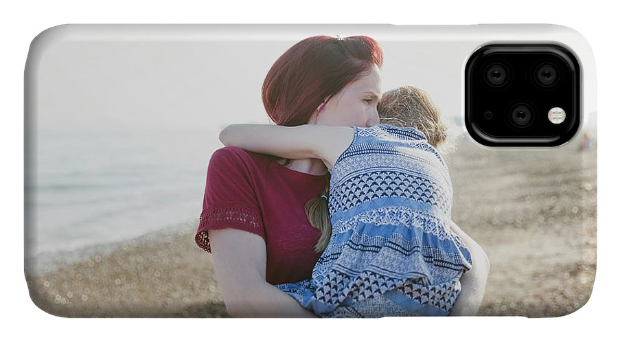 30-34 Years IPhone Case featuring the photograph Mother Holding Daughter On Beach by Caia Image/science Photo Library