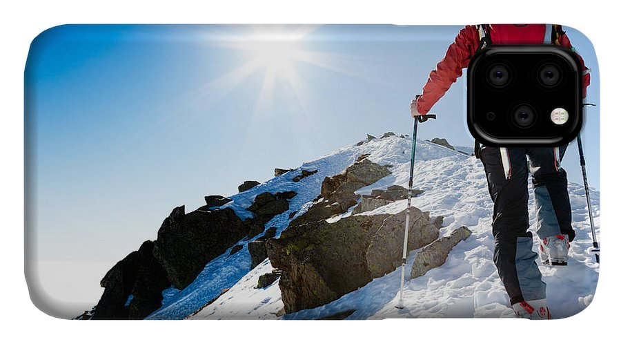 Backcountry IPhone Case featuring the photograph Mountaineer Walking Up Along A Snowy by Roberto Caucino