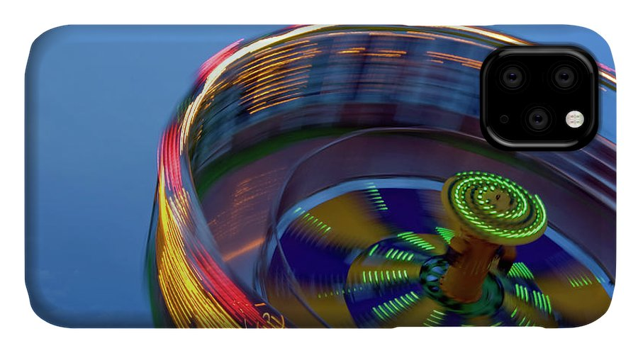 Carousel IPhone Case featuring the photograph Multicolored Spinning Carnival Ride by By Ken Ilio