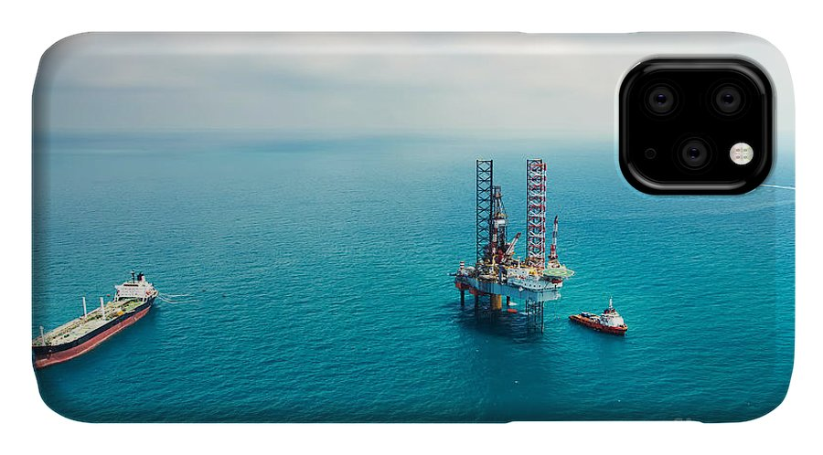 Fuel IPhone Case featuring the photograph Oil Rig In The Gulf by Kanok Sulaiman