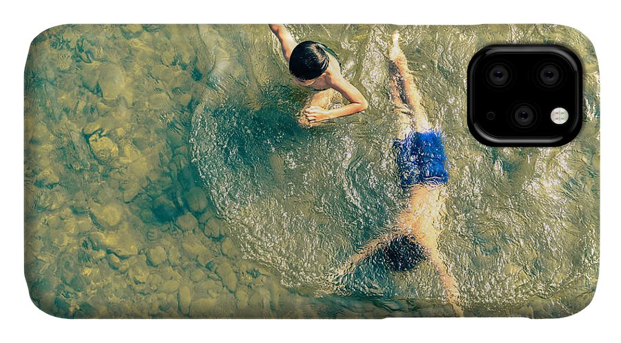 Play IPhone Case featuring the photograph Playful Children Swimming In Nam Song by View Apart