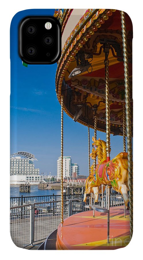 Capital IPhone 11 Case featuring the photograph Pretty Carousel Overlooking Slick by Matthew Dixon