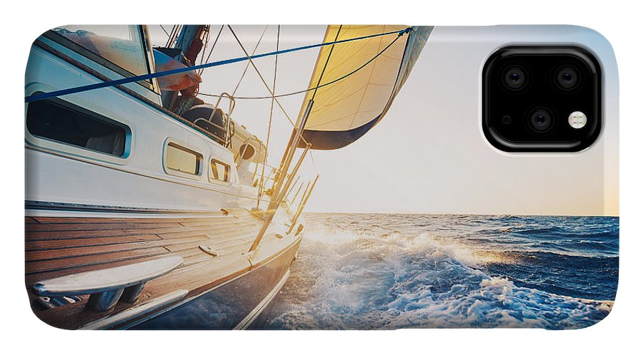 Sailboat IPhone 11 Case featuring the photograph Sailing To The Sunrise by Epicstockmedia