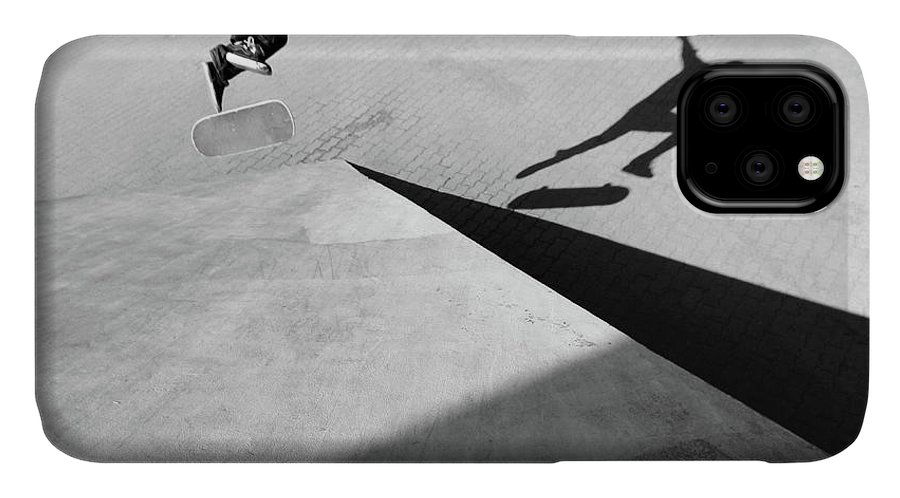 Shadow IPhone Case featuring the photograph Shadow Of Skateboarder by Mgs