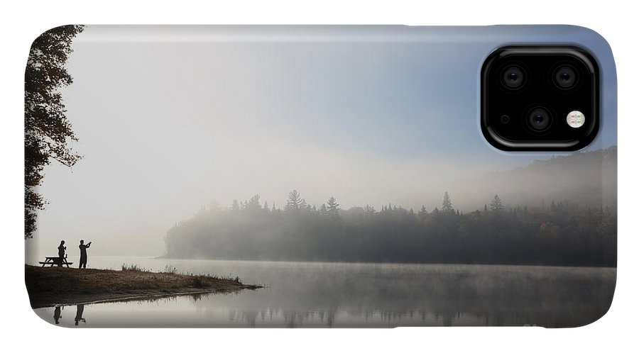 Dusk IPhone 11 Case featuring the photograph Silhouette. Relaxing Morning On Lake by Barisev Roman