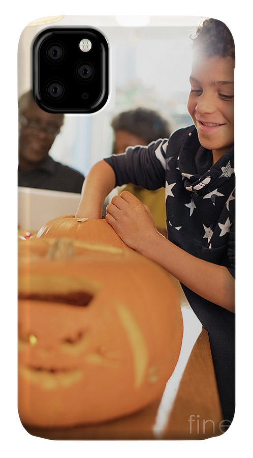 8-9 Years IPhone Case featuring the photograph Smiling Boy Carving Halloween Pumpkins by Caia Image/science Photo Library