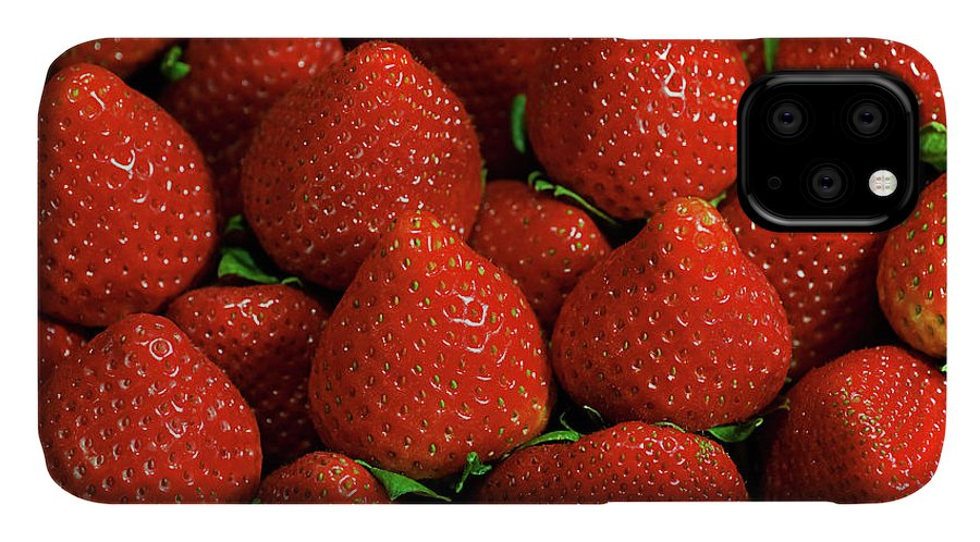 Large Group Of Objects IPhone Case featuring the photograph Strawberry Cliche by By Ken Ilio