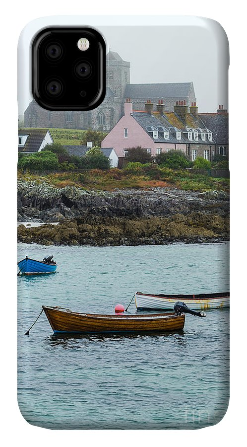 Church IPhone Case featuring the photograph Wooden Vintage Rowboats And Outboard by Lowsun