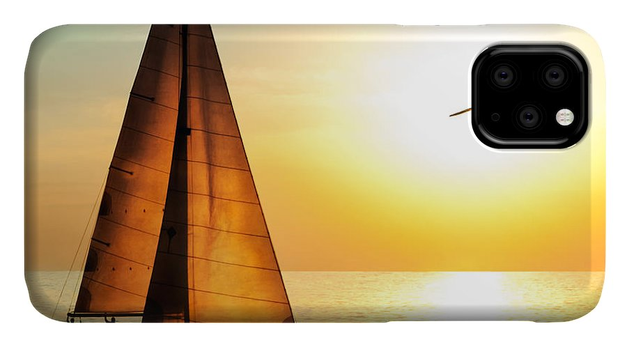 Sailboat IPhone 11 Case featuring the photograph Yacht Sailing Against Sunset. Holiday by Repina Valeriya