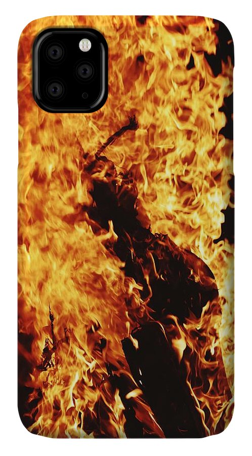 Campfire IPhone Case featuring the photograph Closeup of Fire at time of festival by Ravindra Kumar
