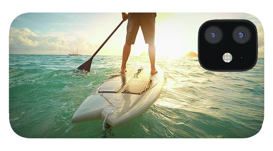 Tranquility IPhone 12 Case featuring the photograph Caucasian Man On Paddle Board In Ocean by Colin Anderson Productions Pty Ltd