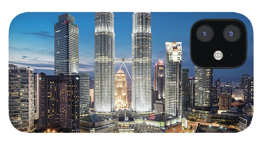 Downtown District iPhone 12 Case featuring the photograph Malaysia, Kuala Lumpur, Petronas Towers by Martin Puddy