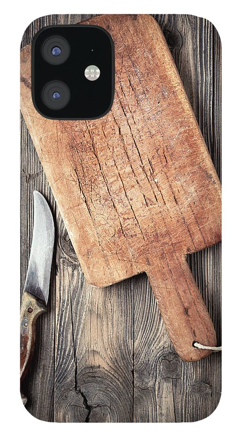 Empty IPhone 12 Case featuring the photograph Old Cutting Board And Knife by Barcin