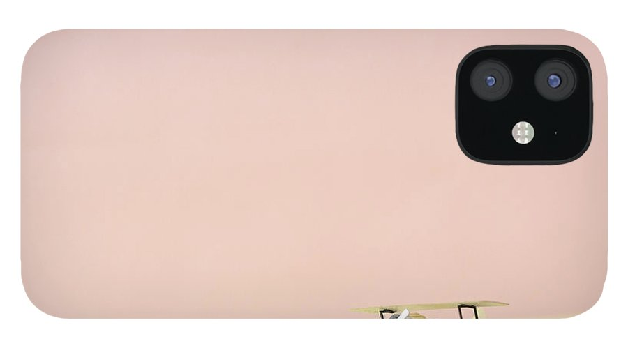 Shadow iPhone 12 Case featuring the photograph The Model Of The Airplane Made Of The by Yagi Studio