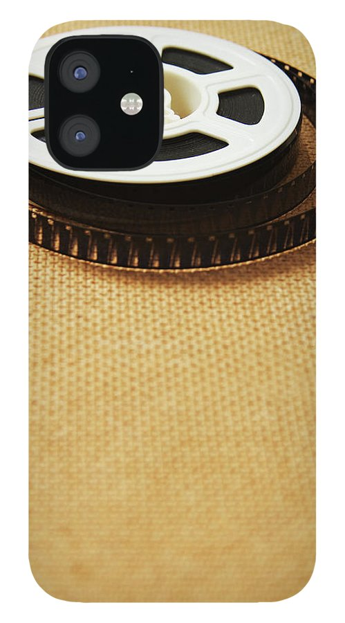 The Media IPhone 12 Case featuring the photograph A Reel, Or Spool, Of 8mm Movie Film by Jon Schulte