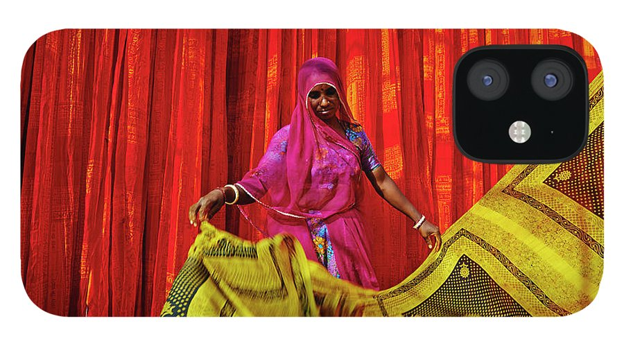 Working IPhone 12 Case featuring the photograph India, Rajasthan, Sari Factory by Tuul & Bruno Morandi