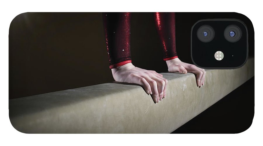 Human Arm iPhone 12 Case featuring the photograph Female Gymnast On Balancing Beam by Mike Harrington