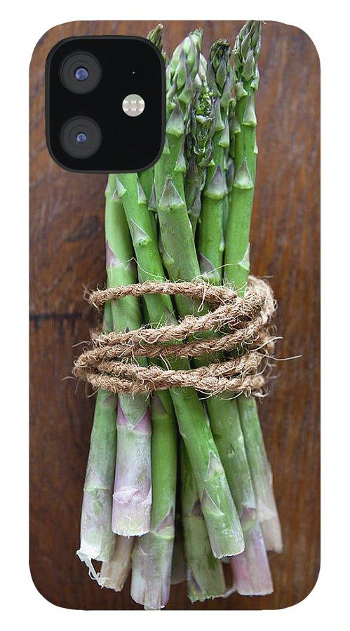Kitchen IPhone 12 Case featuring the photograph A Bundle Of Asparagus by Halfdark