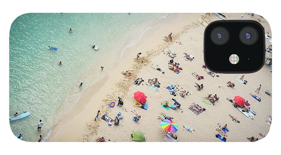 Honolulu IPhone 12 Case featuring the photograph Aerial View Of Tourists On Beach by Alberto Guglielmi