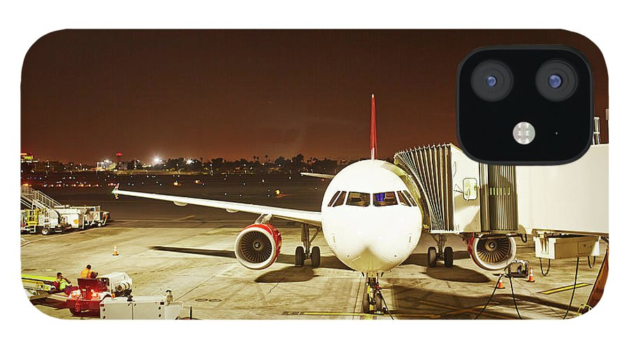 Passenger Boarding Bridge iPhone 12 Case featuring the photograph Airplane Parked At Jetway by Ballyscanlon
