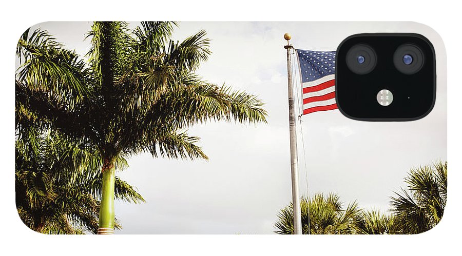 Tranquility IPhone 12 Case featuring the photograph American Flag Flying Amongst Palm Trees by Ron Levine