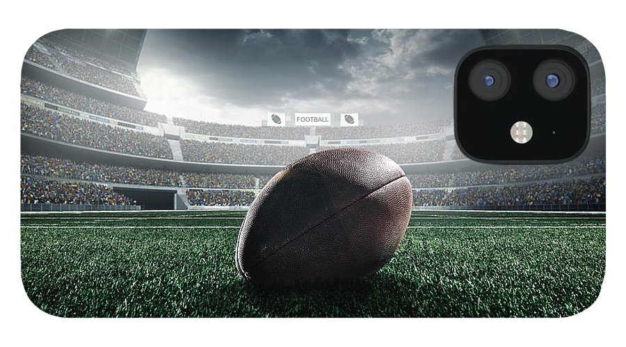 Event IPhone 12 Case featuring the photograph American Football Ball by Dmytro Aksonov