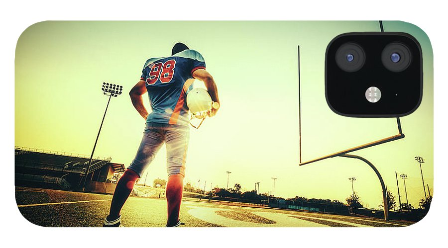 Headwear IPhone 12 Case featuring the photograph American Football Player by Ferrantraite