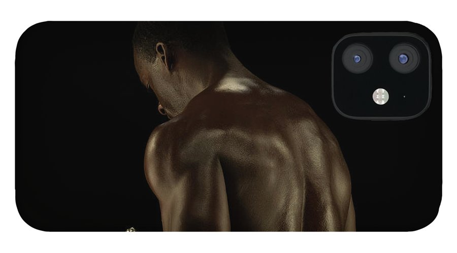 Mature Adult IPhone 12 Case featuring the photograph Athletic Male Exercising With A Hand by Jonathan Knowles