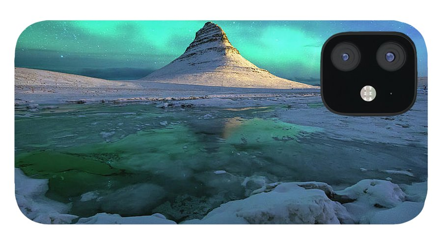 Tranquility IPhone 12 Case featuring the photograph Aurora Over Kirkjufell Mountain Iceland by Ratnakorn Piyasirisorost