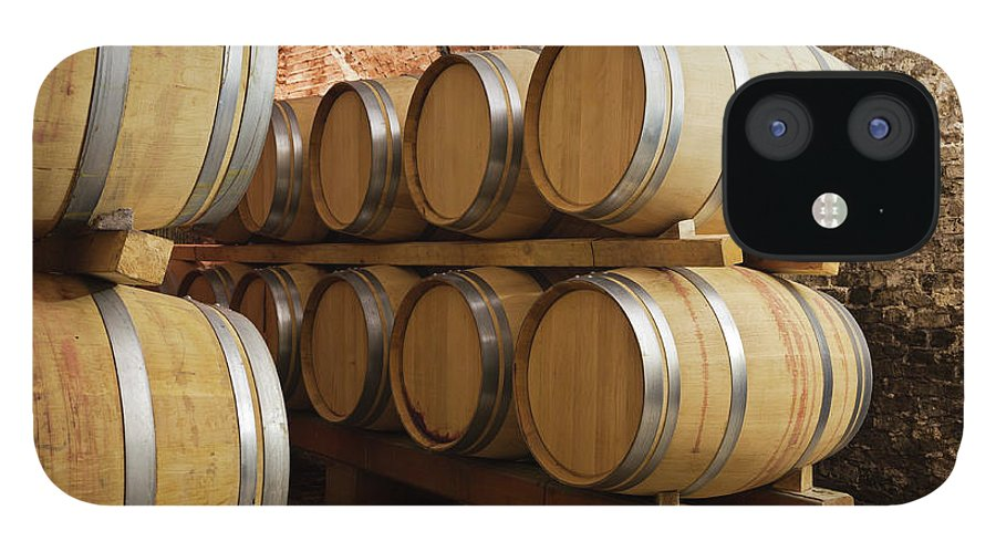 Fermenting IPhone 12 Case featuring the photograph Barrels In Wine Cellar by Stockwerk
