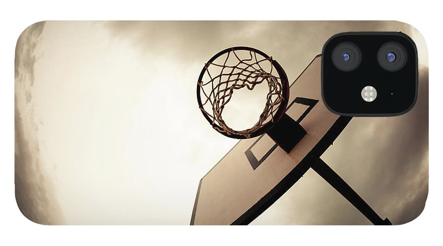 Goal IPhone 12 Case featuring the photograph Basketball Hoop, Dramatic Sky by Zodebala