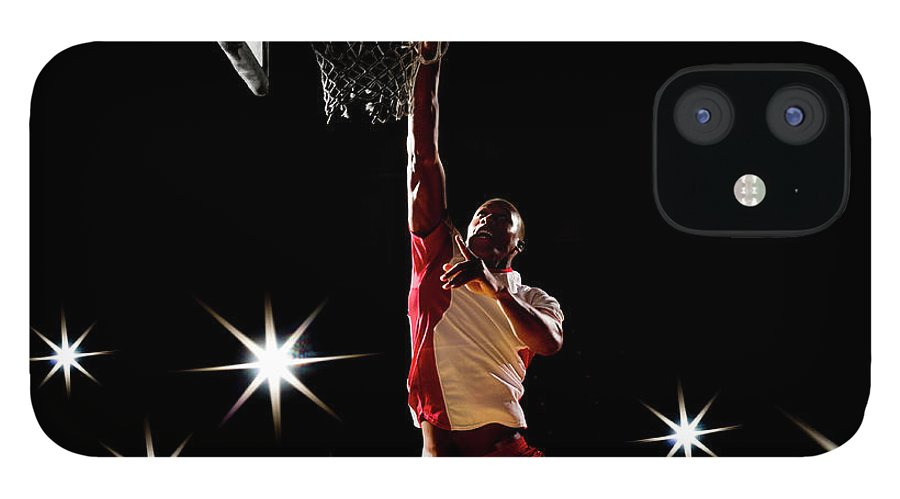 Three Quarter Length iPhone 12 Case featuring the photograph Basketball Player Dunking Basketball On by Compassionate Eye Foundation/chris Newton