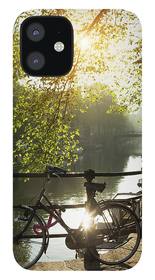 Shadow IPhone 12 Case featuring the photograph Bicycle And Bridge Over Brouwersgracht by Buena Vista Images