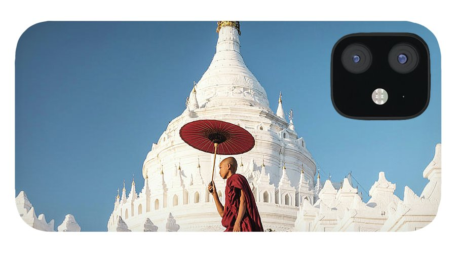 Pagoda IPhone 12 Case featuring the photograph Buddhist Monk Walking Across Arches Of by Martin Puddy