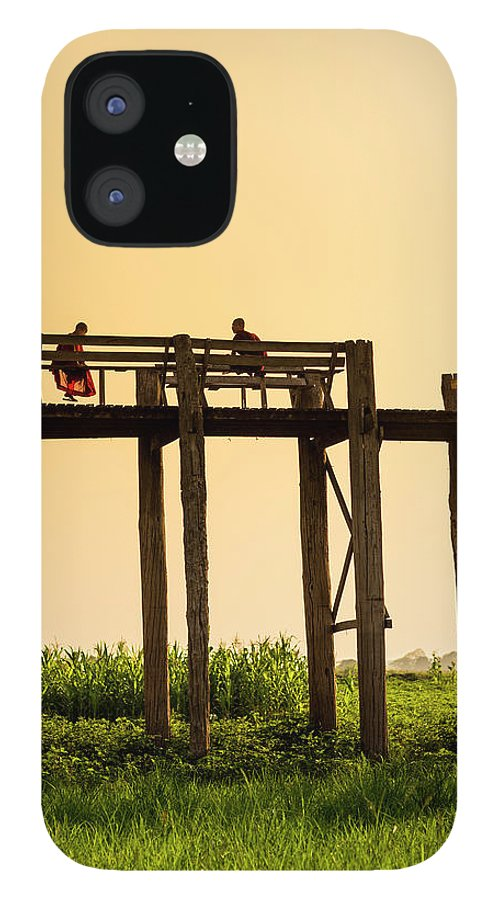 Grass iPhone 12 Case featuring the photograph Buddhist Monks Seated On U Bein Bridge by Merten Snijders