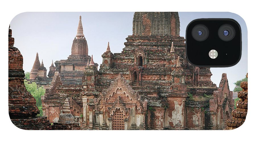 Tranquility IPhone 12 Case featuring the photograph Buddhist Monks Walking Past Temple by Martin Puddy