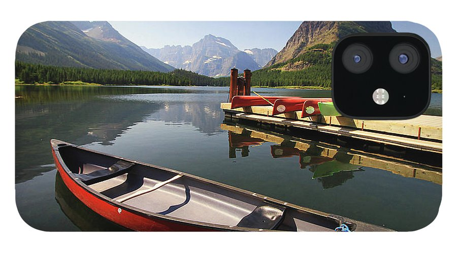 Scenics IPhone 12 Case featuring the photograph Canoe At St Mary Lake In Glacier by L. Toshio Kishiyama