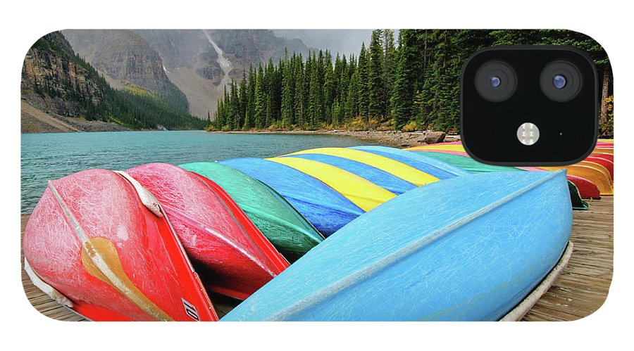 Scenics IPhone 12 Case featuring the photograph Canoes Line Dock At Moraine Lake, Banff by Wildroze