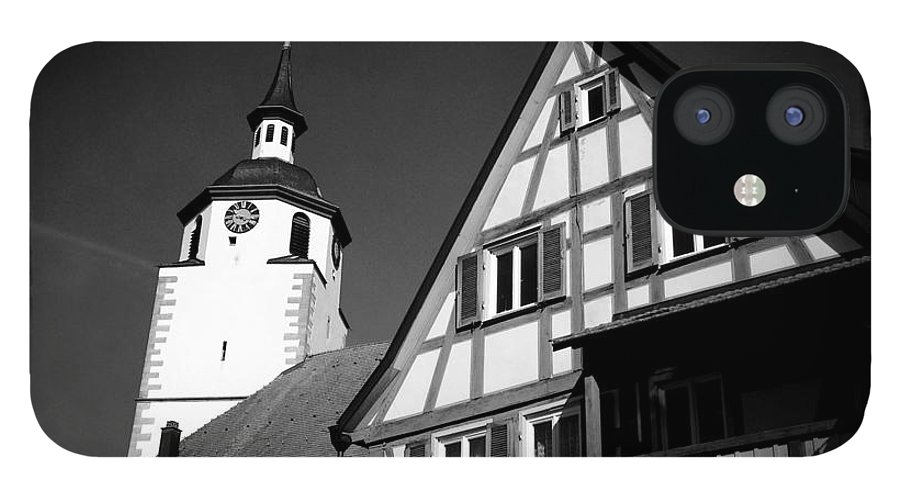 Church IPhone 12 Case featuring the photograph Church and half-timbered house in lovely old town by Matthias Hauser